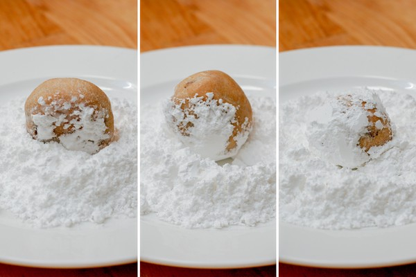 A triptych of a biscuit being rolled in confectioner's sugar on a white plate, where each panel shows the biscuit covered in more sugar